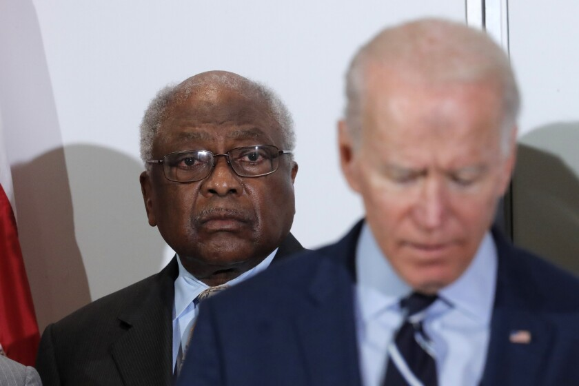 House Majority Whip James Clyburn listens as Joe Biden speaks Feb. 26 in North Charleston, S.C., where Clyburn endorsed the former vice president.