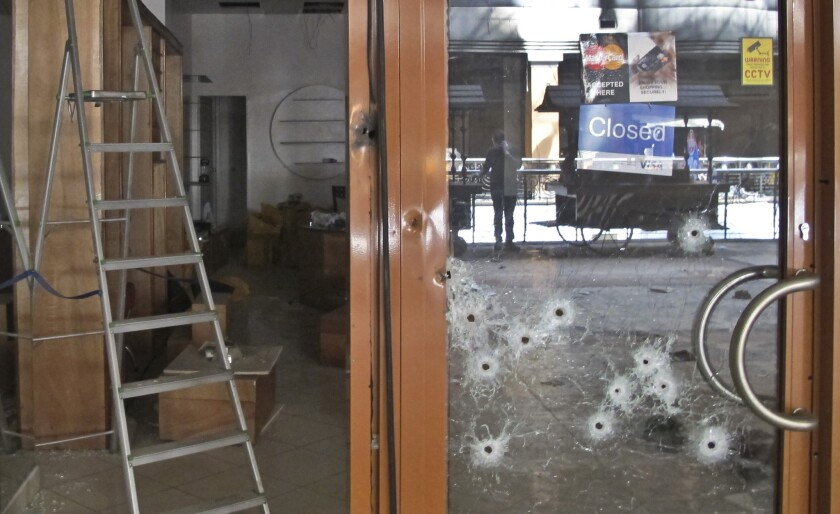 Bullet holes pepper the glass door of a shop in the Westgate Mall in Nairobi on Tuesday.
