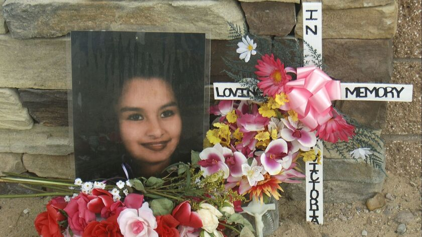 FILE - This Feb. 23, 2009 file photo shows a memorial for Victoria Chavez near the Southwest Mesa ar