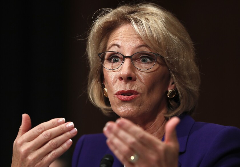 In this Jan. 17, 2017, file photo, Education Secretary-nominee Betsy DeVos testifies on Capitol Hill in Washington.
