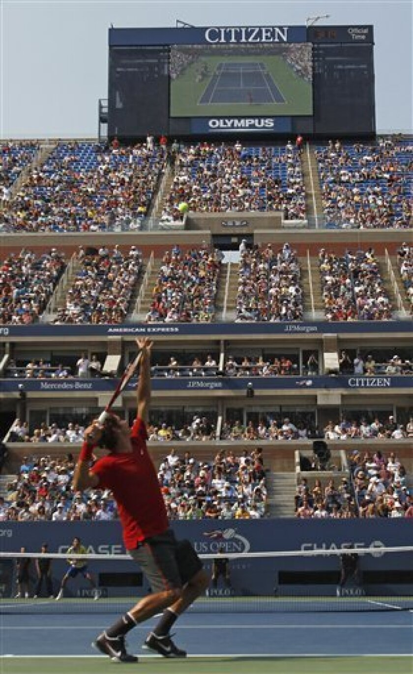 Roger Federer of Switzerland serves to Marin Cilic of Croatia during the U.S. Open tennis tournament in New York, Saturday, Sept. 3, 2011. (AP Photo/Mike Groll)