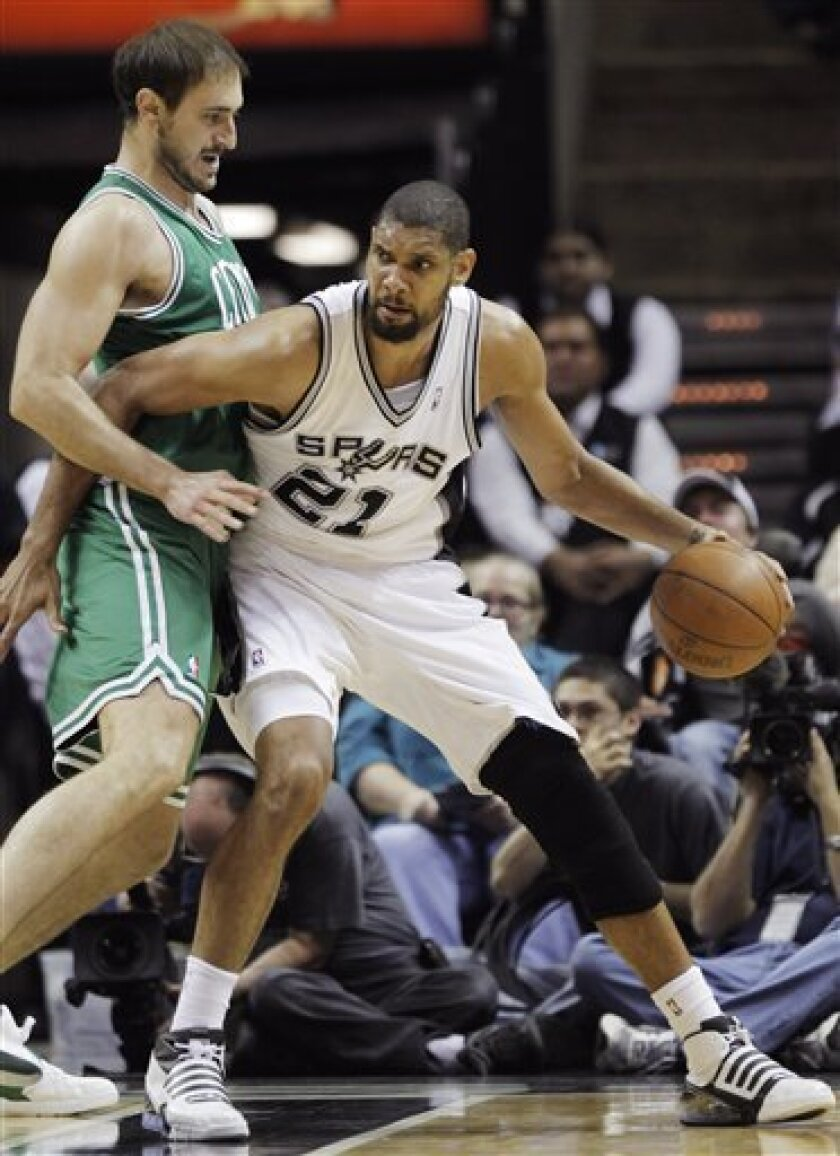 Boston Celtics' Nenad Krstic, left, of Serbia, guards San Antonio Spurs' Tim Duncan during the first half of an NBA basketball game, Thursday, March 31, 2011, in San Antonio. (AP Photo/Darren Abate)