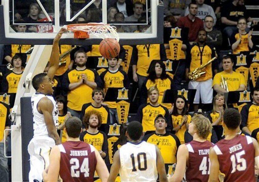 Murray State's Brandon Garrett, left, dunks against Eastern Kentucky during an NCAA college basketball game, Wednesday, Jan. 4, 2012, in Murray, Ky. (AP Photo/The Paducah Sun, John Wright)