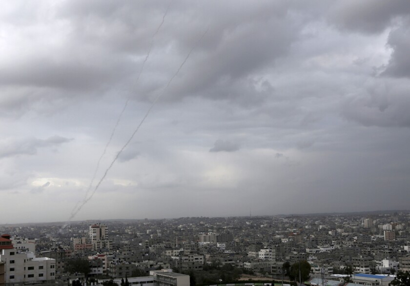 Trails of smoke from rockets fired from the Gaza Strip toward Israel are seen above Gaza City. Israel responded with artillery fire and airstrikes.