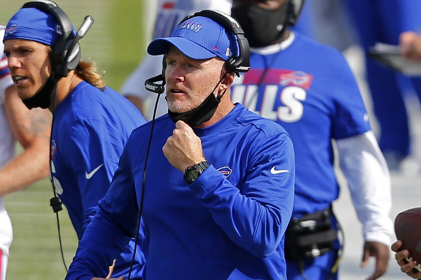 FILE - In this Sept. 13, 2020 file photo, Buffalo Bills head coach Sean McDermott pulls his mask down to give instructions on the sidelines during the second half of an NFL football game against the New York Jets in Orchard Park, N.Y. McDermott pays credit to experiences and advice he gained working under Kansas City coach Andy Reid, while the two were in Philadelphia, including getting fired by Reid in 2010, which McDermott says was the best thing to happen to his career. (AP Photo/Jeffrey T. Barnes, File)