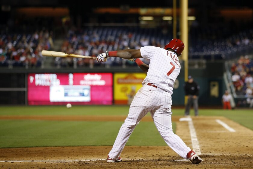 Philadelphia Phillies' Maikel Franco follows through after hitting an RBI-single off Pittsburgh Pirates relief pitcher Justin Wilson during the seventh inning of a baseball game, Tuesday, Sept. 9, 2014, in Philadelphia. Philadelphia won 4-3. (AP Photo/Matt Slocum)