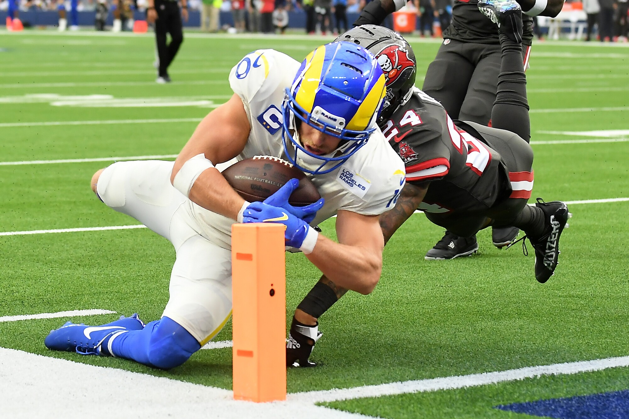 Rams wide receiver Cooper Kupp dives for the end zone to score a touchdown in front of Buccaneers cornerback Carlton Davis.