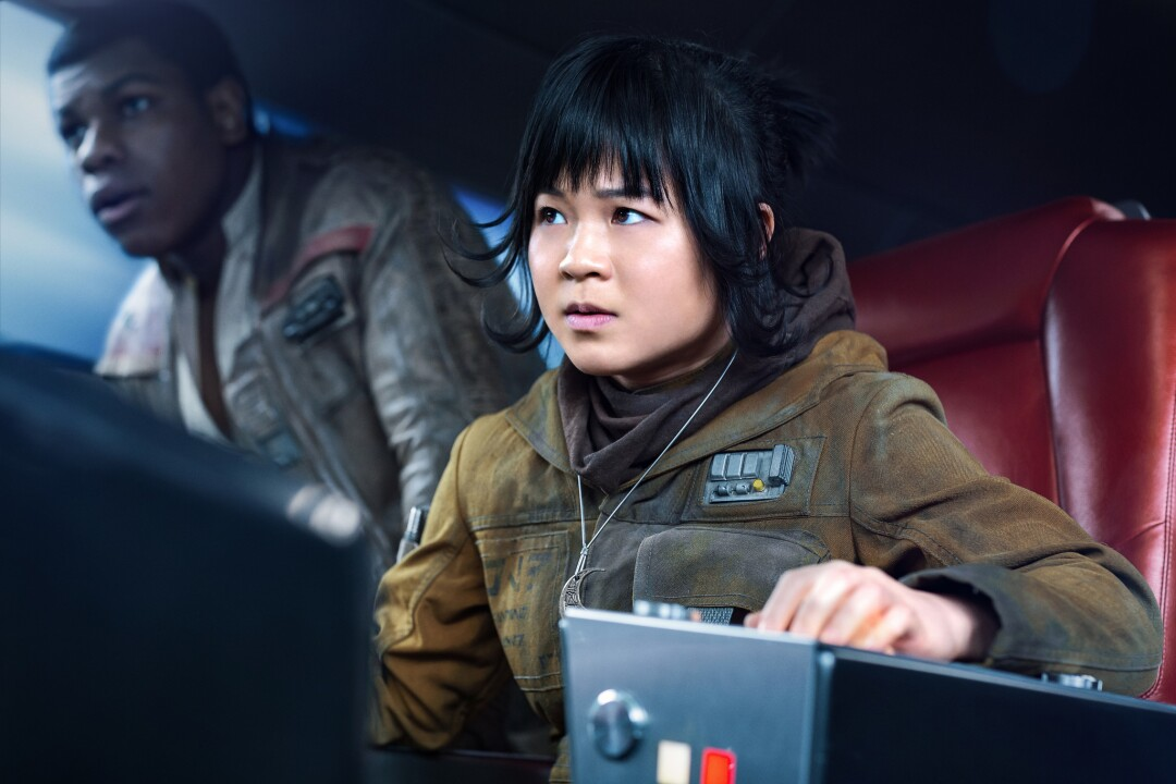 "John Boyega as Finn, left, and Kelly Marie Tran as Rose in ""Star Wars: The Last Jedi."""