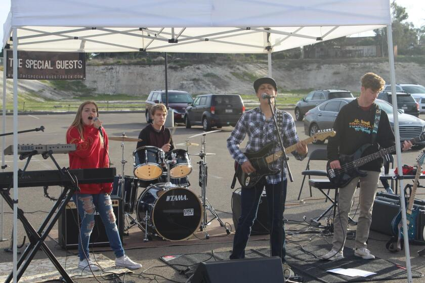 The Special Guests perform, a rock band featuring local students.