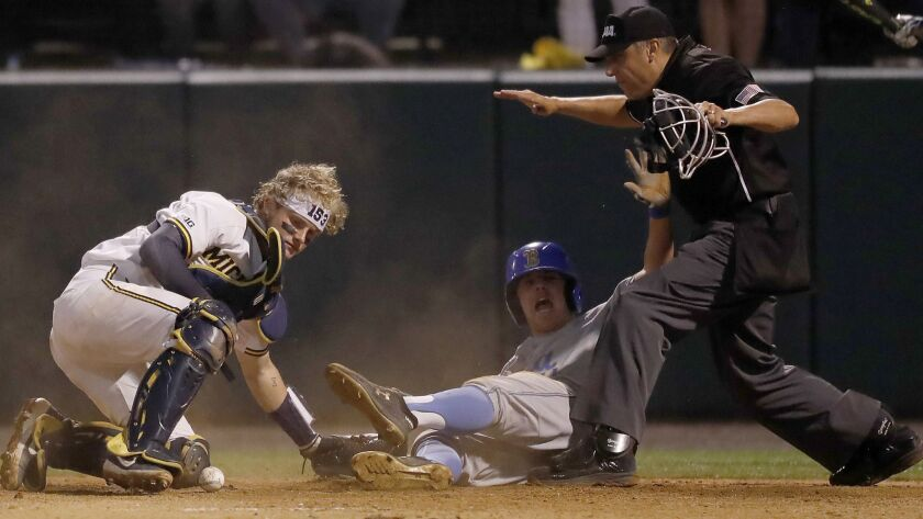 LOS ANGELES, CALIF. - JUNE 8, 2019. UCLA infielder Jake Mob erg is safe at home with the go ahead