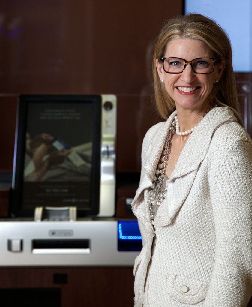 """San Diego market manager at Chase Bank Nikki Atkins Hartung introduces the """"next generation"""" ATM technology at Chase Bank, which customers can use with a new credit card security feature in a new chip on their card."""