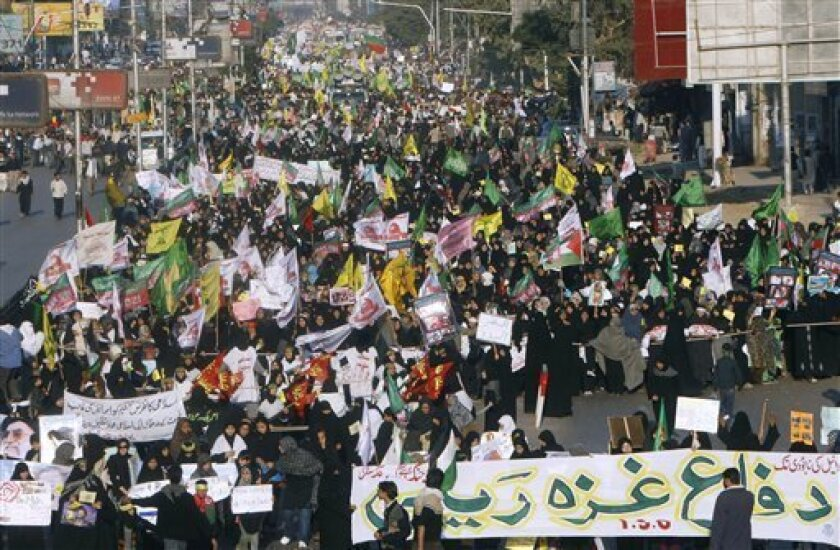 Thousands of supporters of a Pakistani Shiite Muslims group 'Imamia Students Organization' participate in a rally to condemn Israeli military attacks on Gaza, Sunday, Jan. 11, 2009 in Islamabad, Pakistan. (AP Photo/Fareed Khan)