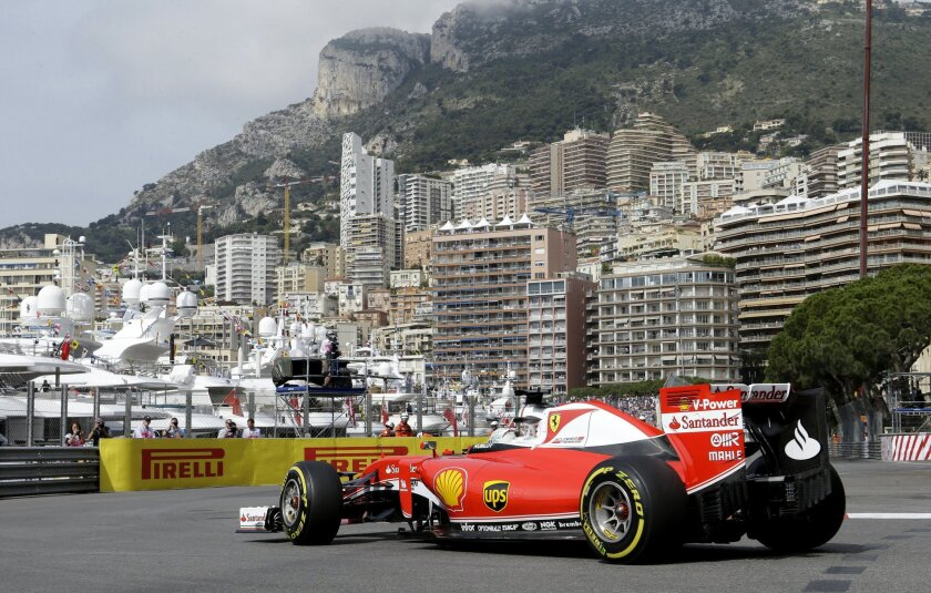 Ferrari driver Sebastian Vettel of Germany steers his car during the first free practice at the Monaco racetrack in Monaco, Monaco, Thursday, May 26, 2016. The Formula one race will be held on Sunday. (AP Photo/Claude Paris)