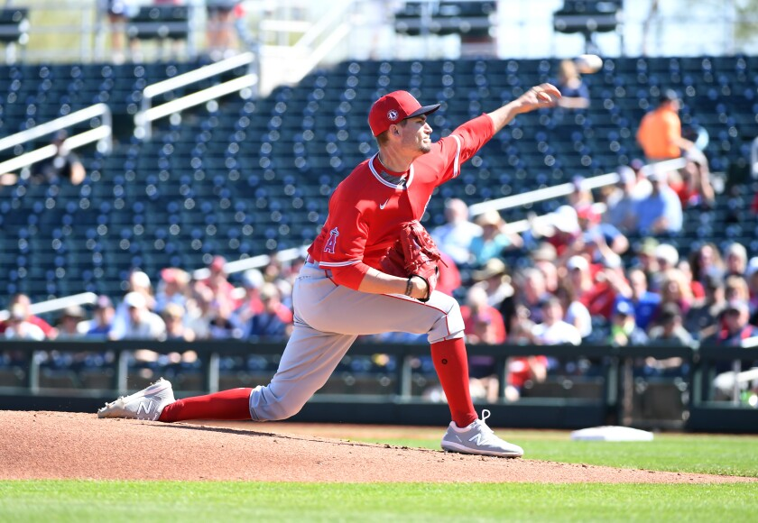 Angels starting pitcher Andrew Heaney delivers during a spring training game against the Cleveland Indians on Tuesday.