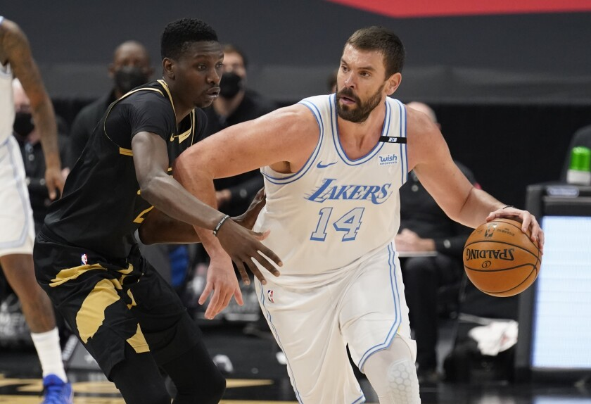 Lakers center Marc Gasol drives at Toronto Raptors forward Chris Boucher.