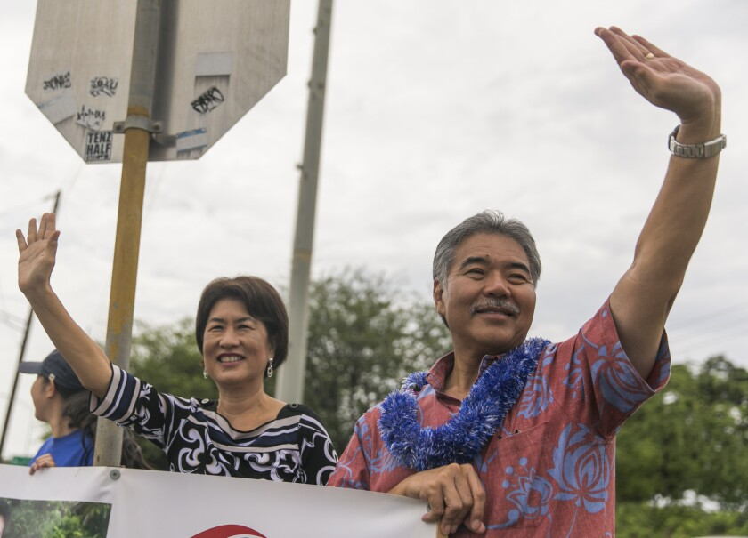 Hawaii State Sen. David Ige defeated Gov. Neil Abercrombie for the Democratic nomination for governor. Above, Ige doing some last-minute campaigning with his wife, Dawn.