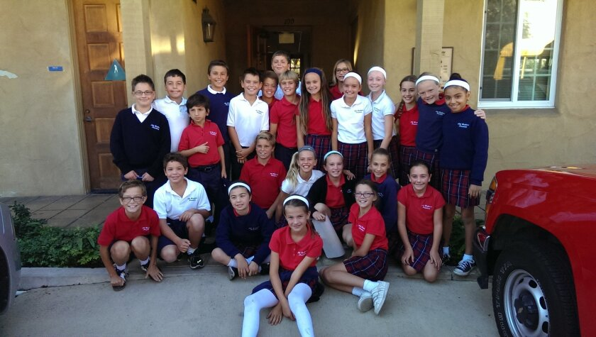 When the doorbell rang this year for la Jolla Meals On Wheels participants, one of these friendly faces from the fifth-grade class at All Hallows Academy was bringing lunch. Courtesy