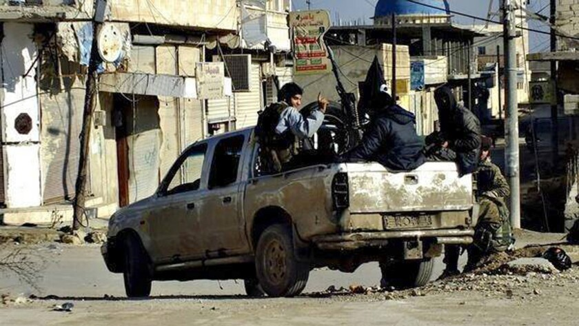 Islamic State fighters travel through Raqqa, Syria, in an undated image posted on a militant website on Jan. 14.