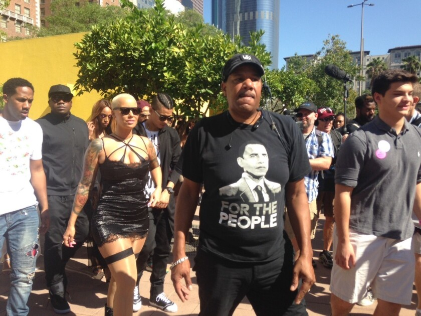 Model Amber Rose, left, leads demonstration at Pershing Square to protest sexism and abuse of women.