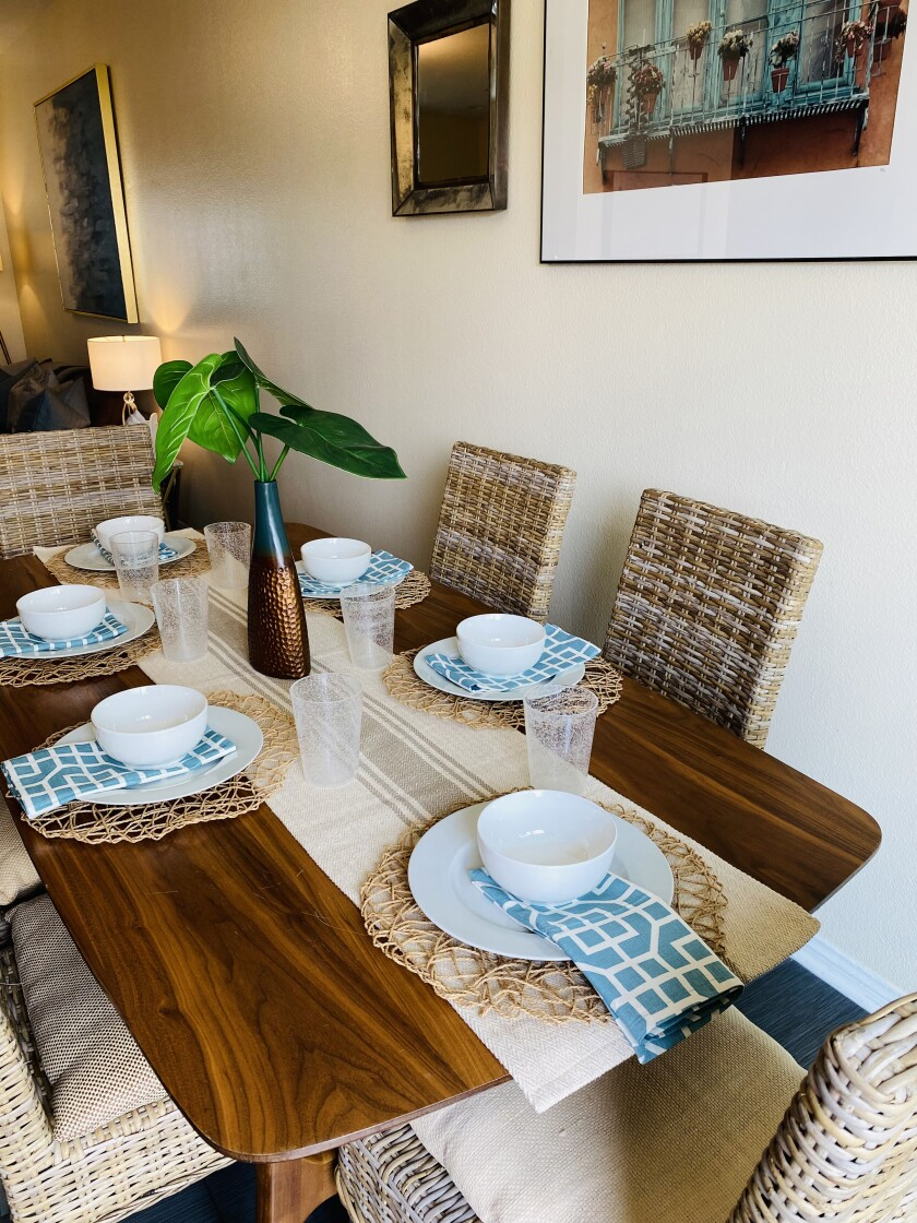 The newly decorated dining room is complete with tableware donations.