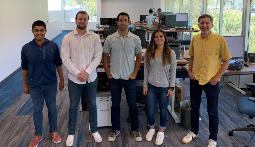 The Blooma team at the company's Sandbox headquarters. From left to right: Ricardo Carranza (senior UI/UX developer), Conner Herron (intern), Shayne Skaff (co-founder and CEO), Hannah Gilliland (associate), and Nick Rice (product manager).