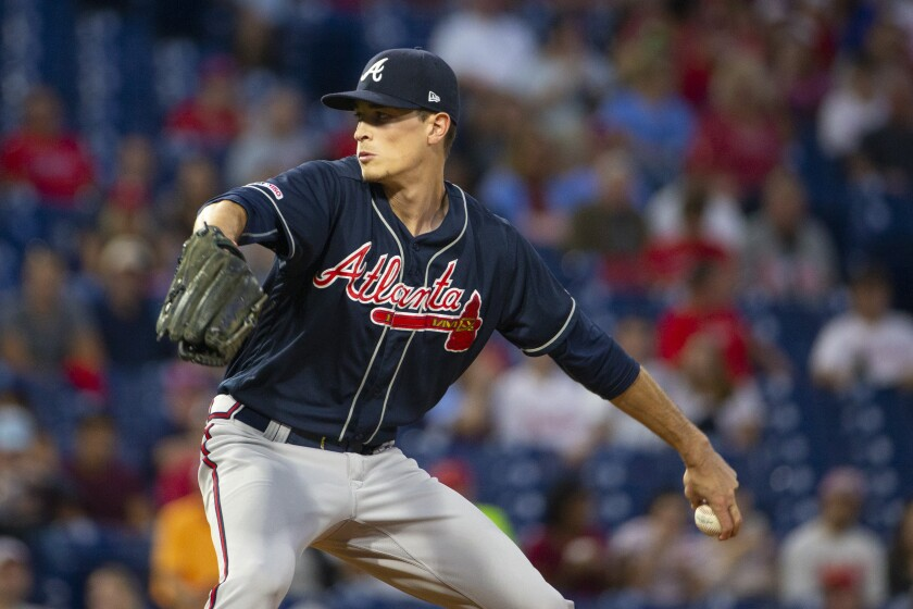 Atlanta's Max Fried prepares to unleash a pitch.