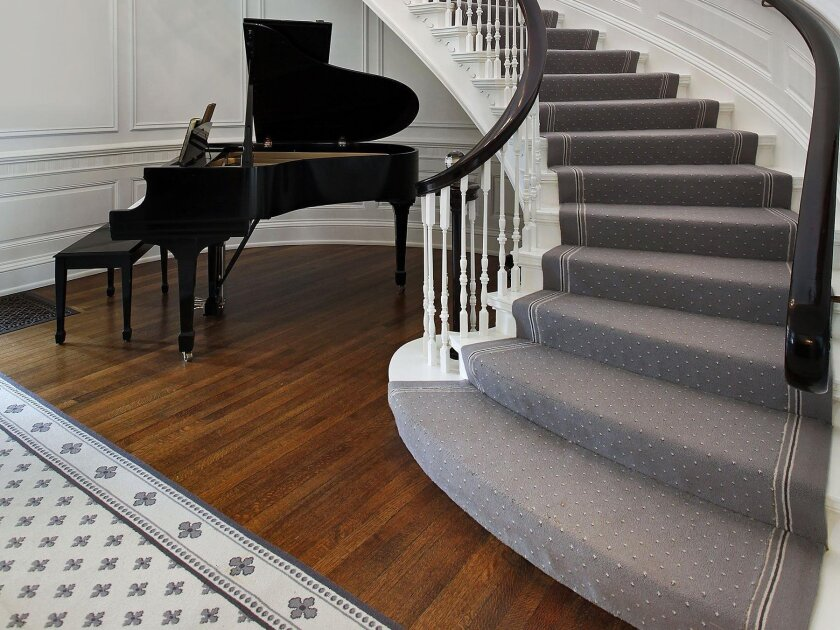 A carpet runner adds stability to wood stairs.