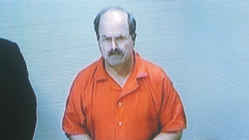 Dennis Rader, the BTK killer, during an arraignment in 2005, is working on a book about the murders.