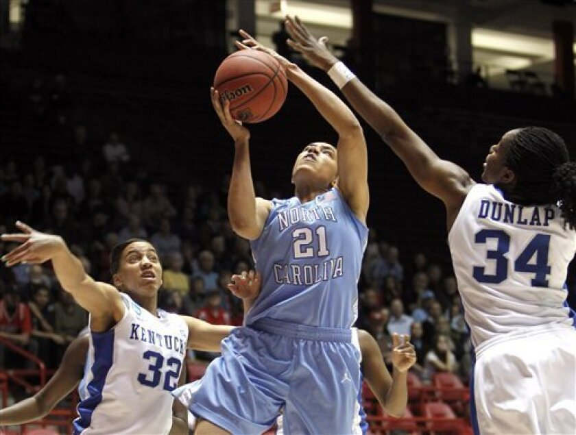 North Carolina's Krista Gross (21) goes up for a shot against Kentucky's Victoria Dunlap (34) and Kastine Evans (32) during the first half of a second-round NCAA women's college basketball game, Monday, March 21, 2011, in Albuquerque, N.M. (AP Photo/Ross D. Franklin)