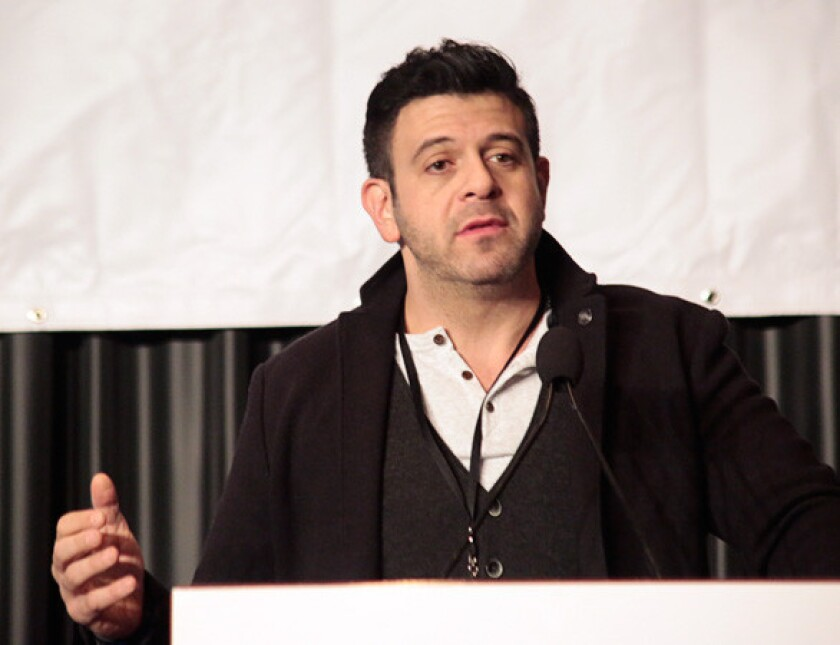 """""""Find out about those local gems,"""" food man Adam Richman advised visitors to the L.A. Times Travel Show on Sunday."""