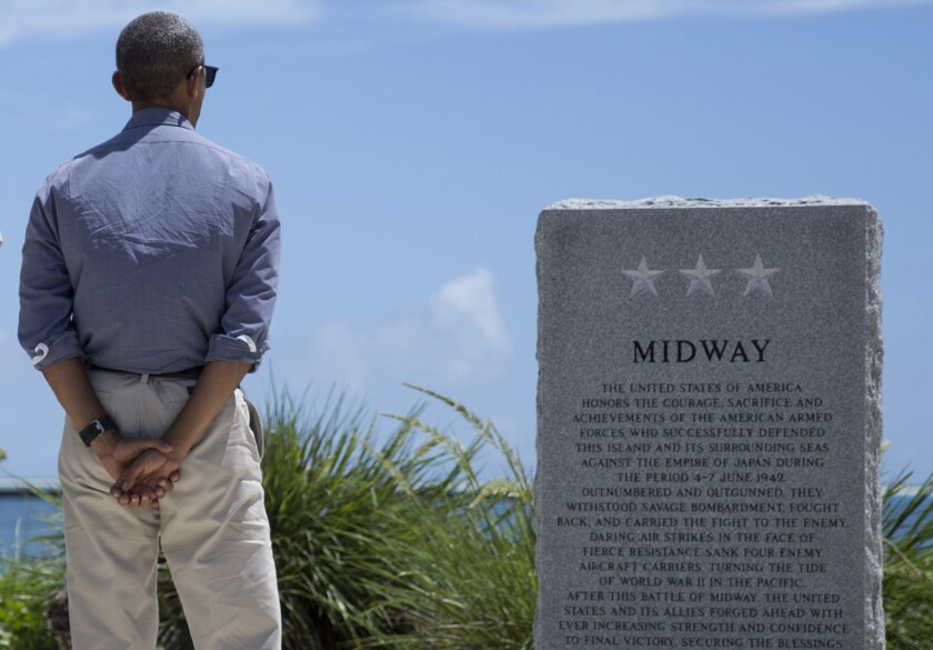 President Obama pauses at the Battle of Midway Navy Memorial in September as he tours Midway Atoll in the Papahanaumokuakea Marine National Monument.