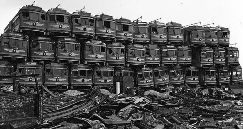 Old Pacific Electric Red Cars sit at Terminal Island junkyard, awaiting becoming scrap metal on March 19, 1956.