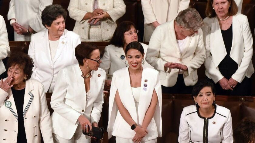 House Democratic women, including Rep. Alexandria Ocasio-Cortez (D-N.Y.), middle, dressed in white for the State of the Union address in tribute to the suffragettes of a century ago.