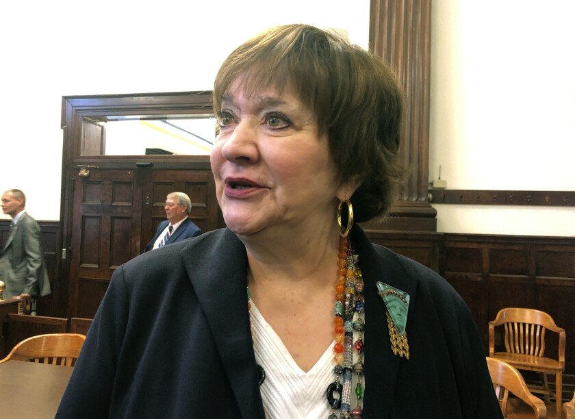 West Virginia Supreme Court Justice Margaret Workman pauses at Boone County Circuit Court in Madison, W.Va., Monday, Oct. 7, 2019. The U.S. Supreme Court is leaving in place a decision that derailed the impeachment trials of three West Virginia Supreme Court justices, including Workman. (AP Photo/John Raby)