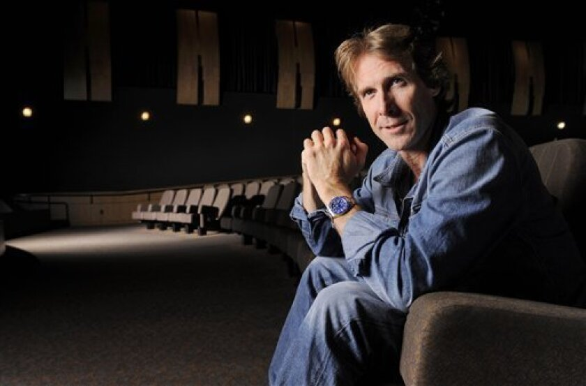 """In this June 15, 2011 photo, filmmaker Michael Bay poses for a portrait at Paramount Theatre in Los Angeles. Bay directed the upcoming film, """"Transformers: Dark of the Moon."""" (AP Photo/Chris Pizzello)"""