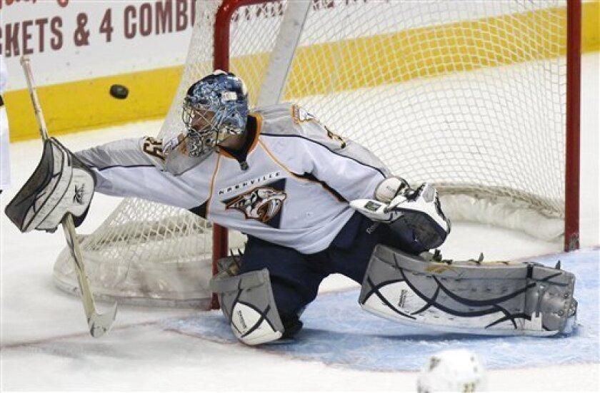 Nashville Predators goalie Dan Ellis blocks a shot in the second period of an NHL hockey game against the Atlanta Thrashers on Tuesday, March 9, 2010, in Atlanta. (AP Photo/John Bazemore)