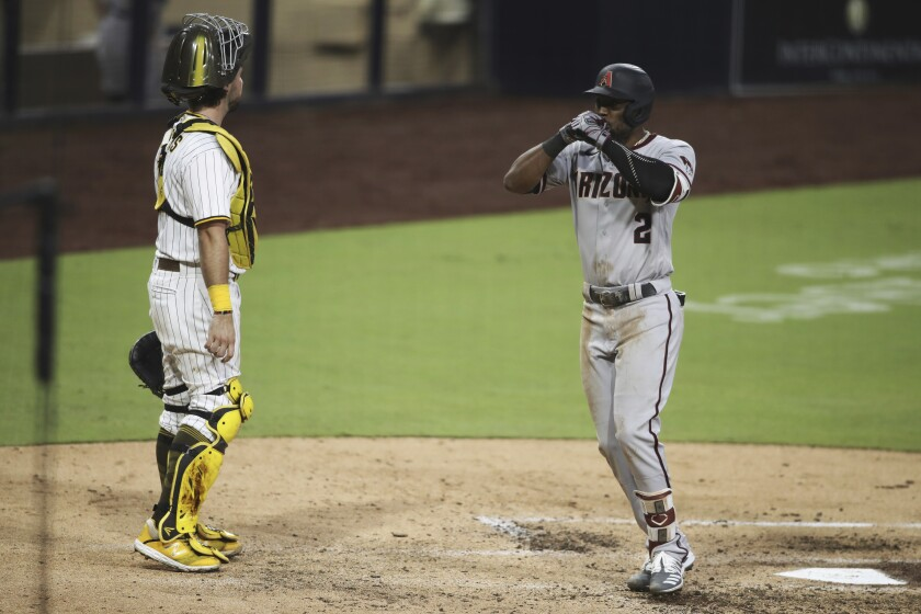 Arizona Diamondbacks' Starling Marte celebrates as he crosses home after hitting a solo home run against the San Diego Padres during the sixth inning of a baseball game Saturday, Aug. 8, 2020, in San Diego. (AP Photo/Derrick Tuskan)