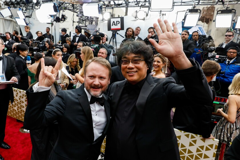 Rian Johnson, left, and Bong Joon Hoarriving at the 92nd Academy Awards.