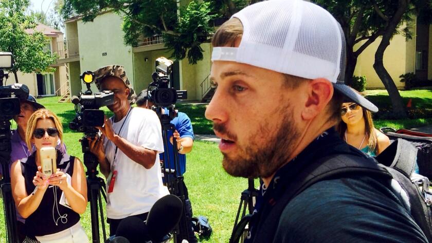 Rams quarterback Case Keenum addresses the media after arriving at camp on Thursday.