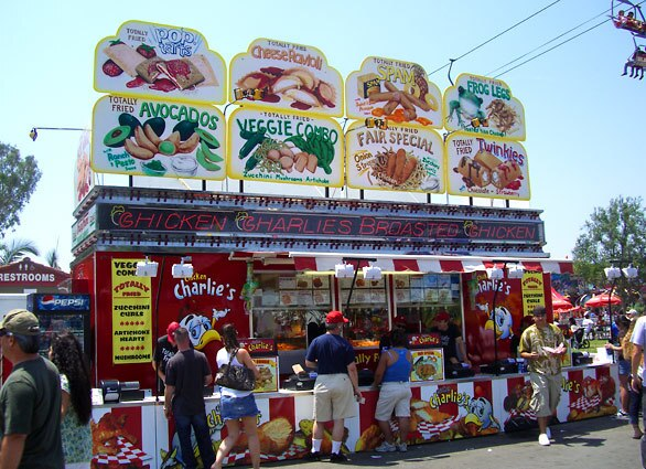 Our examination of fried food at the Orange County Fair started humbly, but Chicken Charlie's has expanded its empire of grease to become the epicenter of all that is battered and fried in fair-land. We took a tour of these battered, grease-soaked wonders.