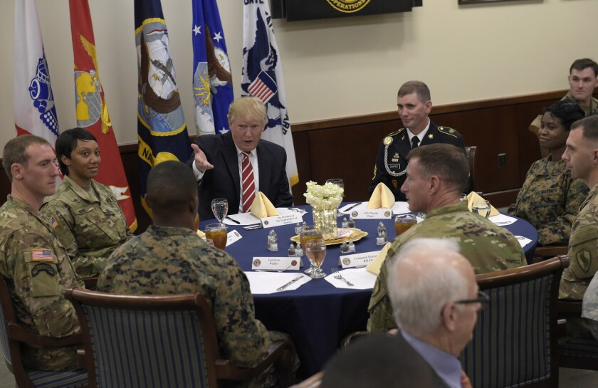 President Donald Trump has lunch with troops while visiting U.S. Central Command and U.S. Special Operations Command. Trump, who spent the weekend at Mar-a-Lago, stopped for a visit to the headquarters before returning to Washington.