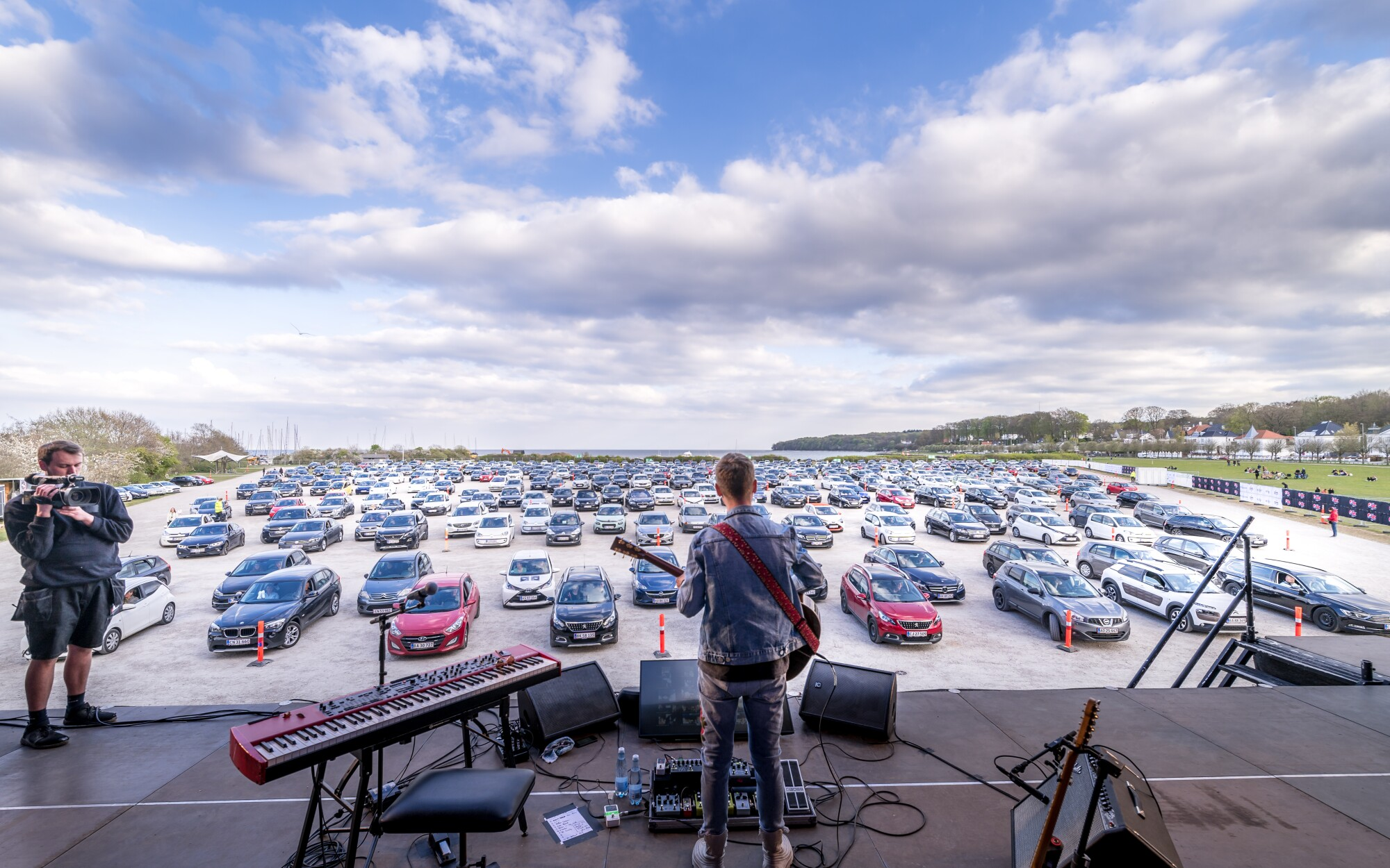 Singer-songwriter Mads Langer is shown performing a drive-in concert in Aarhus, Denmark.