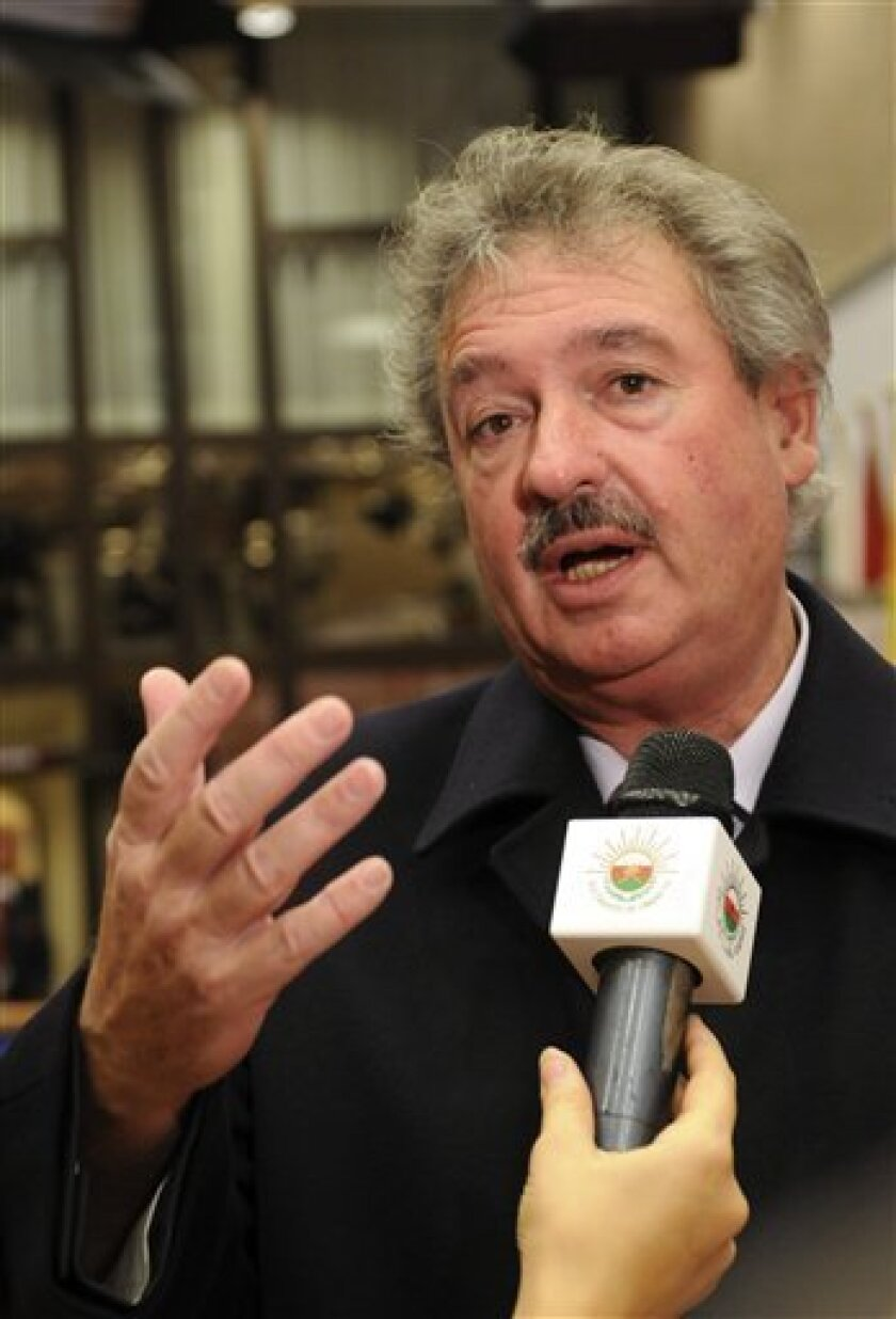 Luxembourg's Foreign Affairs Minister Jean Asselborn gestures while speaking with journalists upon his arrival for the start of the EU Foreign Affairs Council of Ministers held at the EU Council building in Brussels, Tuesday Dec. 8, 2009. (AP Photo/Thierry Charlier)