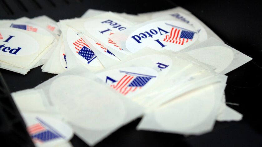 """A stack of """"I voted"""" stickers"""