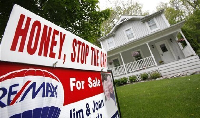 In this May 23, 2011 photo, a home is shown for sale in Chagrin Falls, Ohio. Home prices have reached their lowest points since the housing bubble burst in 2006, driven down by foreclosures, a glut of unsold homes and the reluctance or inability of many to buy. (AP Photo/Amy Sancetta)