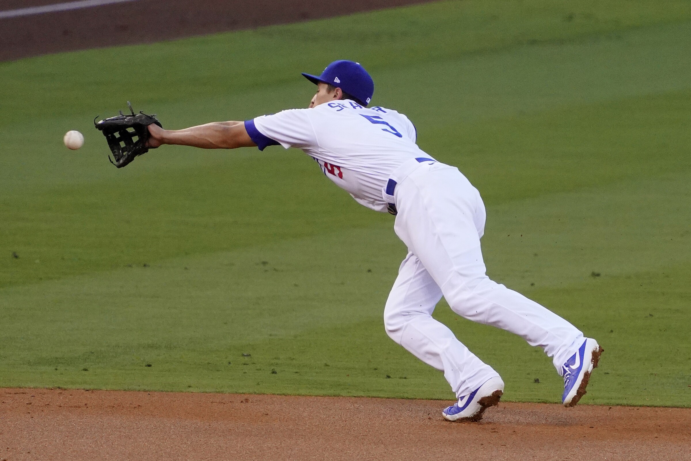 Dodgers shortstop Corey Seager can't reach a ball hit by the Giants on Aug. 7, 2020.
