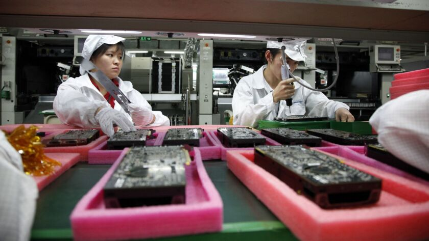China - Hi Tech Industry - Hon Hai Group's Foxconn plant assembly line workers