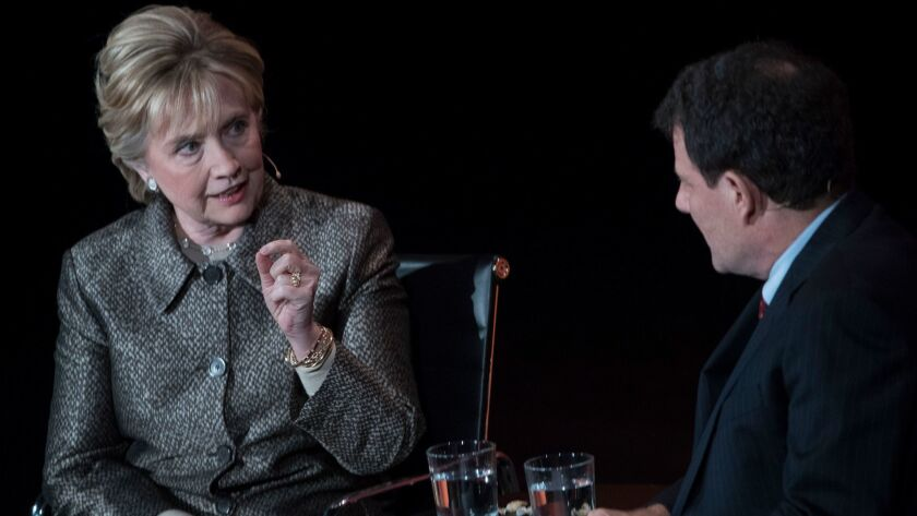 Clinton is interviewed on stage by Nicholas Kristof of the New York Times.