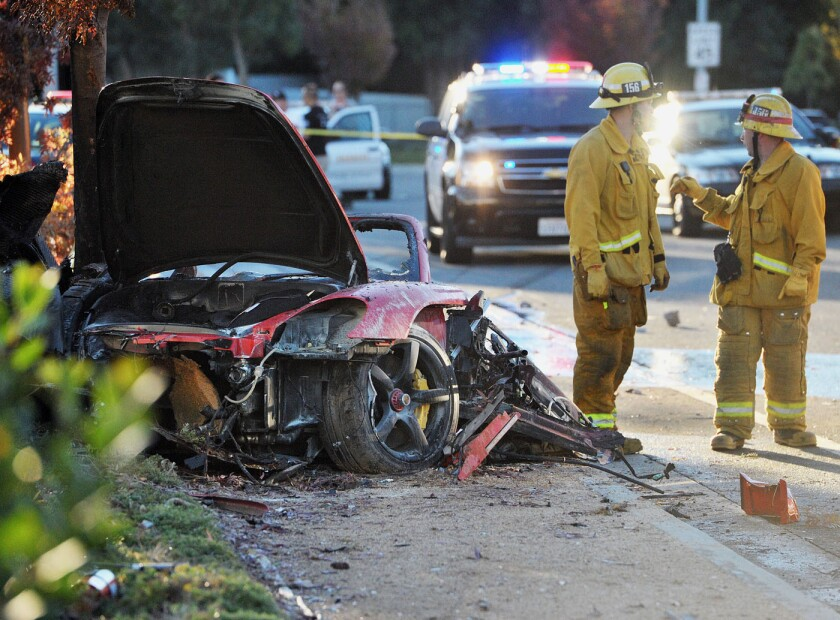 """Fast and Furious"" actor Paul Walker and another man died when their Porsche sports car crashed into a light pole in Santa Clarita. Above, the mangled and burned vehicle after the crash."