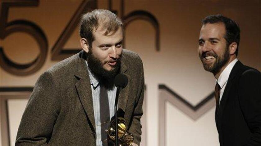 Justin Vernon, of Bon Iver, left, accepts the alternative music album award at the 54th annual Grammy Awards pre-show on Sunday, Feb. 12, 2012 in Los Angeles. (AP Photo/Matt Sayles) - (/ AP)